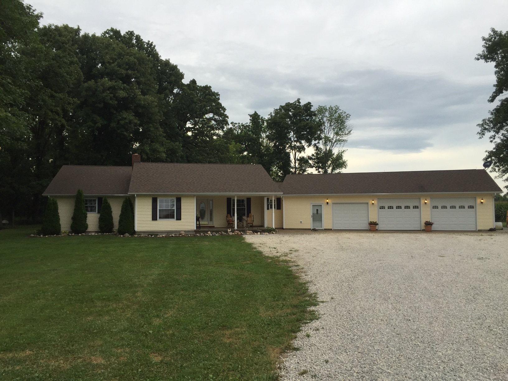 Amazing describes this ranch style home on approx 5 acres for Ranch house with garage